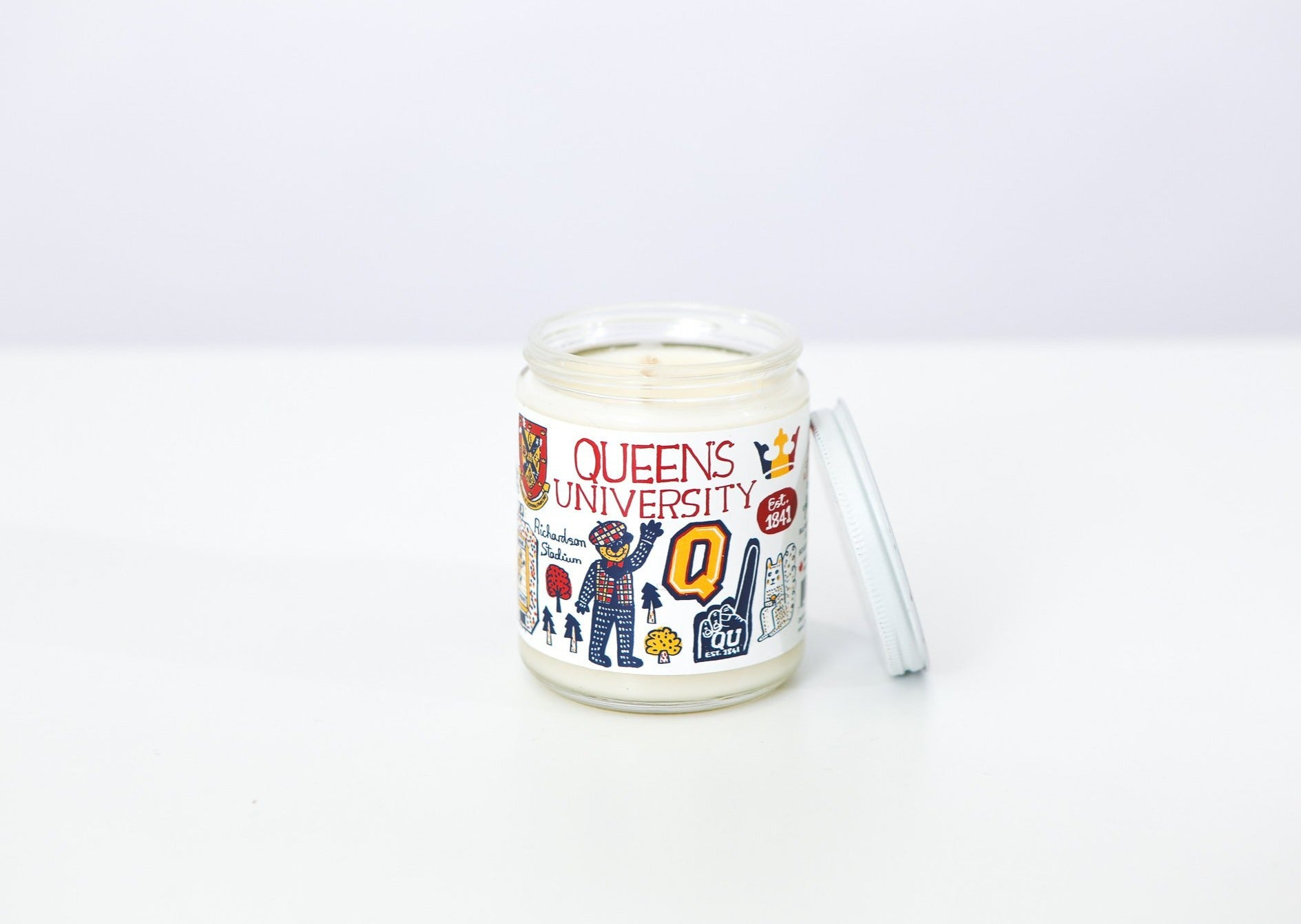 Candle with Queen's themed illustrations