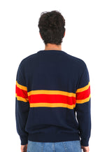 Back view of navy knit sweater with two yellow stripes and one red stripe across the middle
