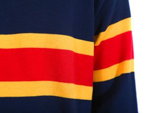 Close up of navy knit sweater with two yellow stripes and one red stripe across the middle