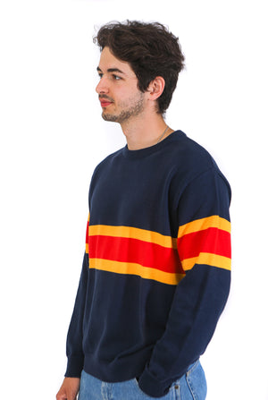 Side view of front of navy knit sweater with two yellow stripes and one red stripe across the middle