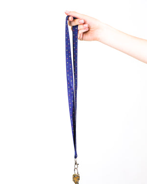 blue lanyard with small blue yellow and red crowns