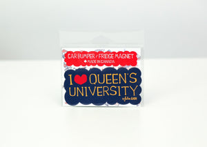 Navy car bumper magnet that says I <3 Queen's University in yellow with a red heart