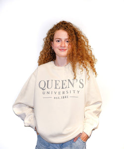 Cream coloured crewneck with silver embroidered Queen's University