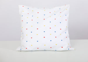 Design option 1: Small crowns all over white pillow cases in the colours of red, blue and yellow