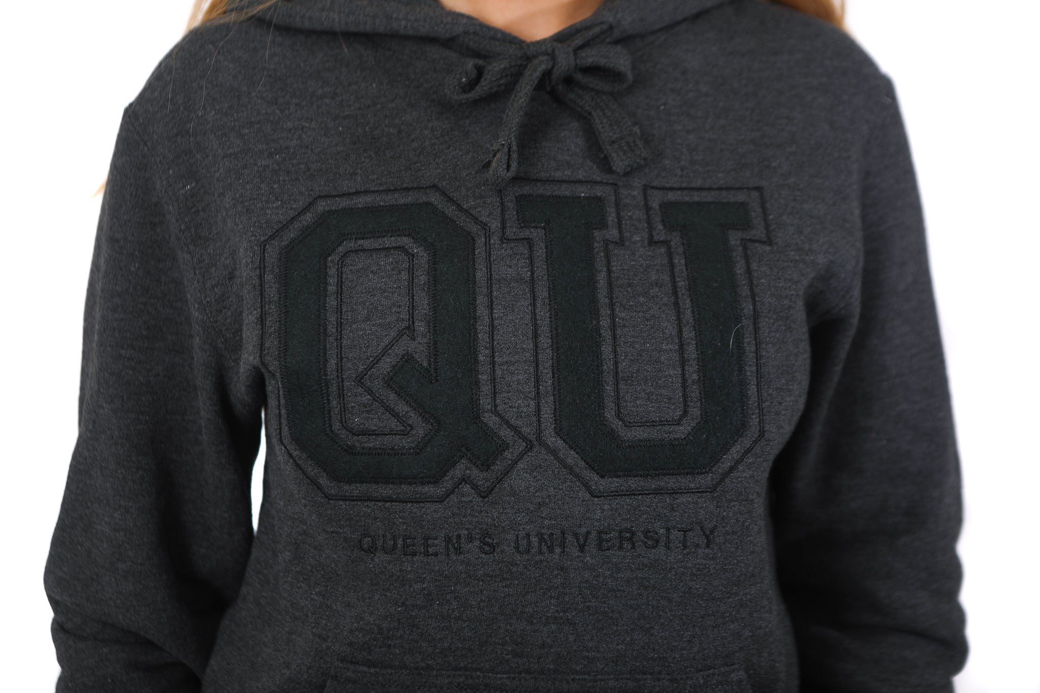 Close up of grey hoodie with charcoal QU