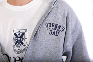 Close up of grey zip up hoodie with Queen's Dad embroidered on the chest