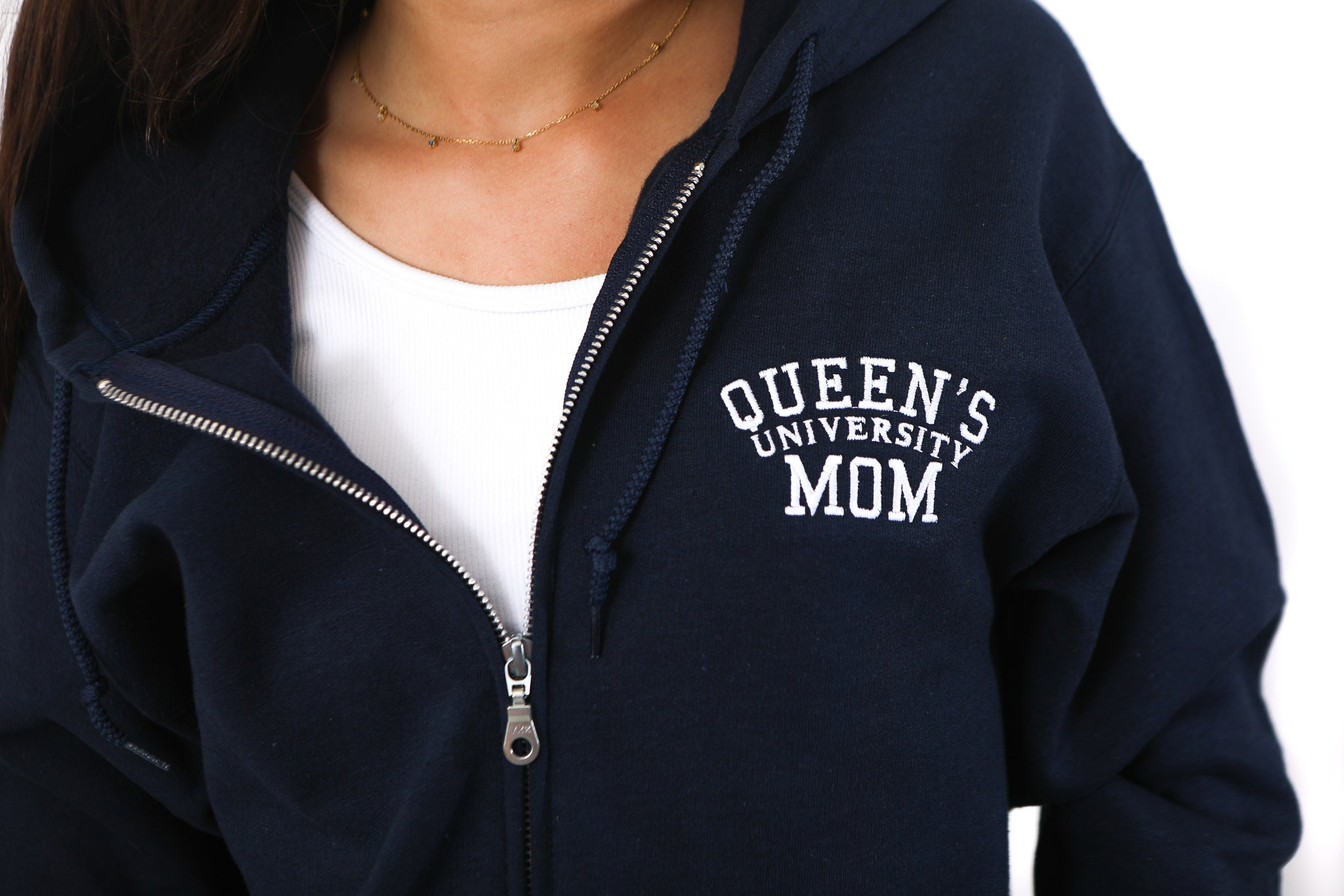 Close up of Queen's Mom logo