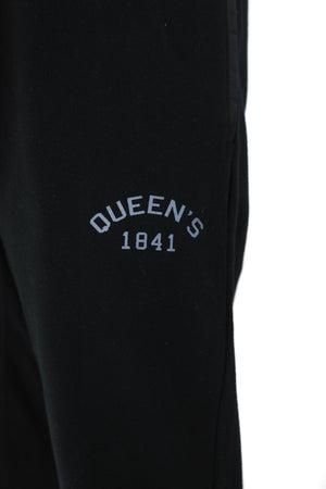 Close up of white Queen's logo on black sweatpants