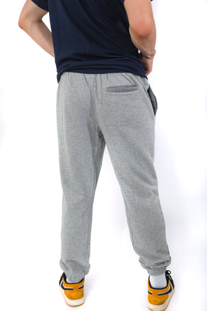 Back of grey sweatpants with one back pocket