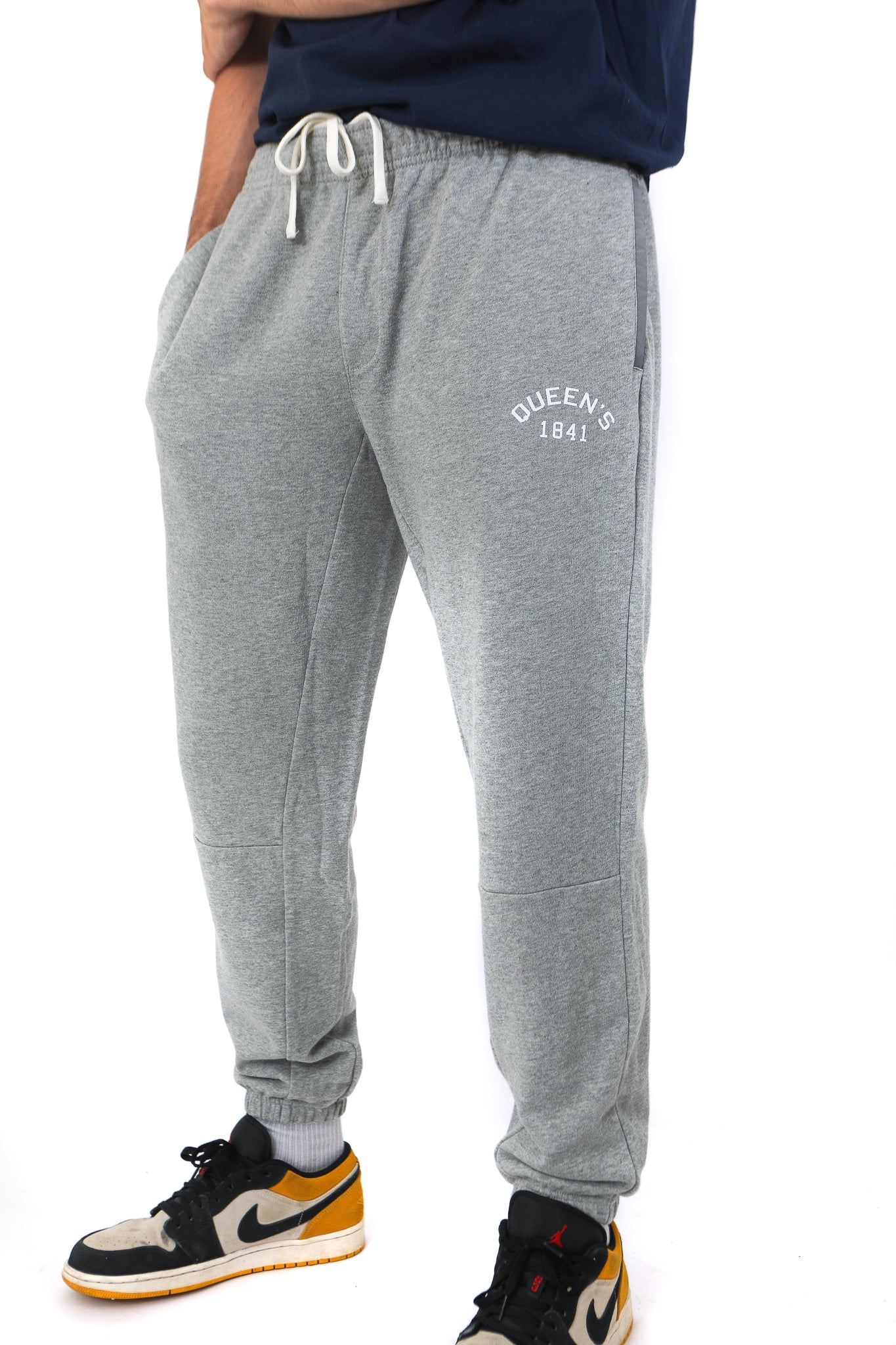 Grey sweatpants with white Queen's logo