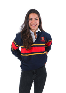 Model in navy rugby shirt with yellow stripes and a thick red stripe across chest