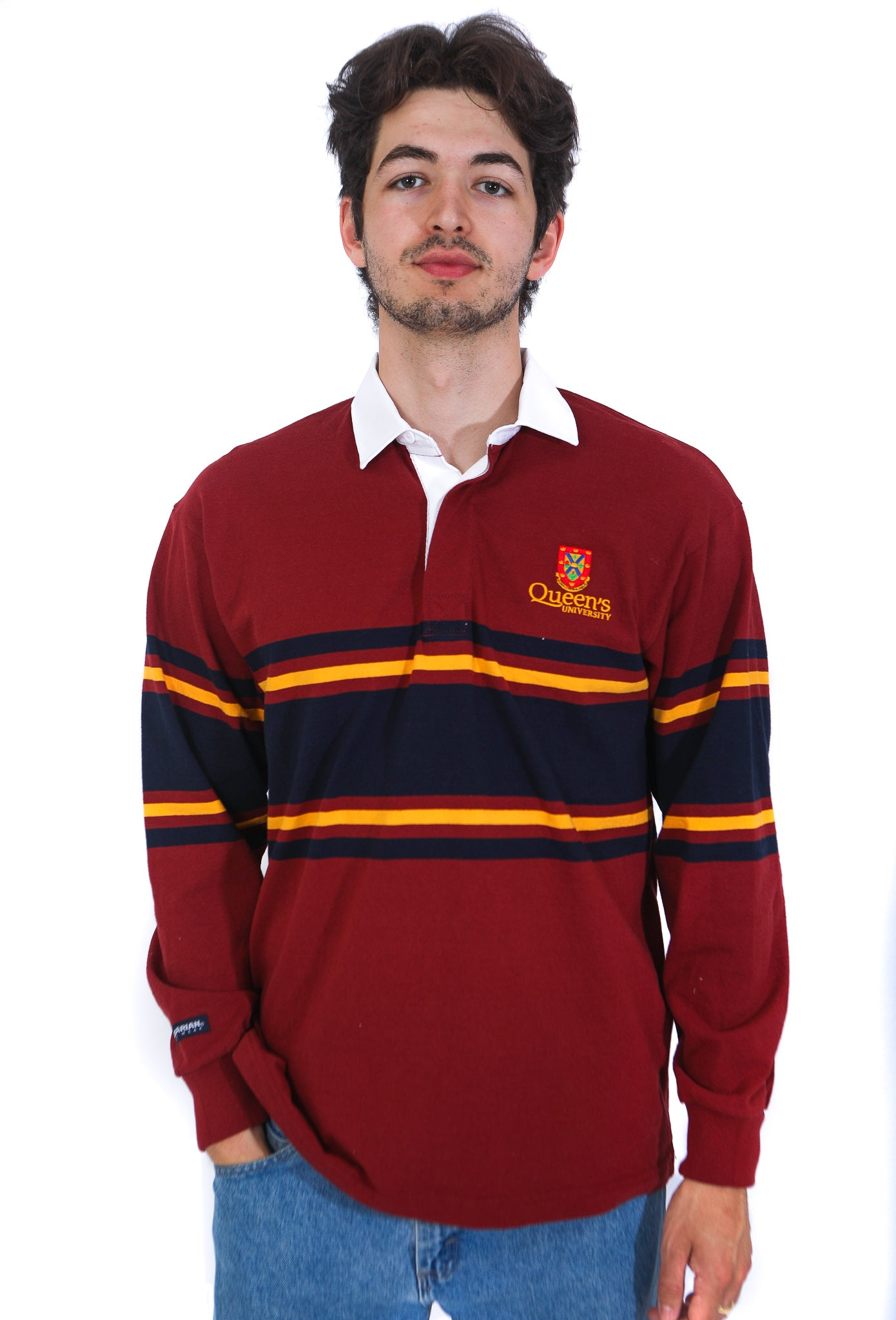 Model in burgundy rugby shirt with thin navy and yellow stripes and a thick navy stripe across chest