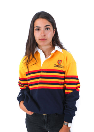Model in yellow rugby shirt with thin red and navy stripes across chest