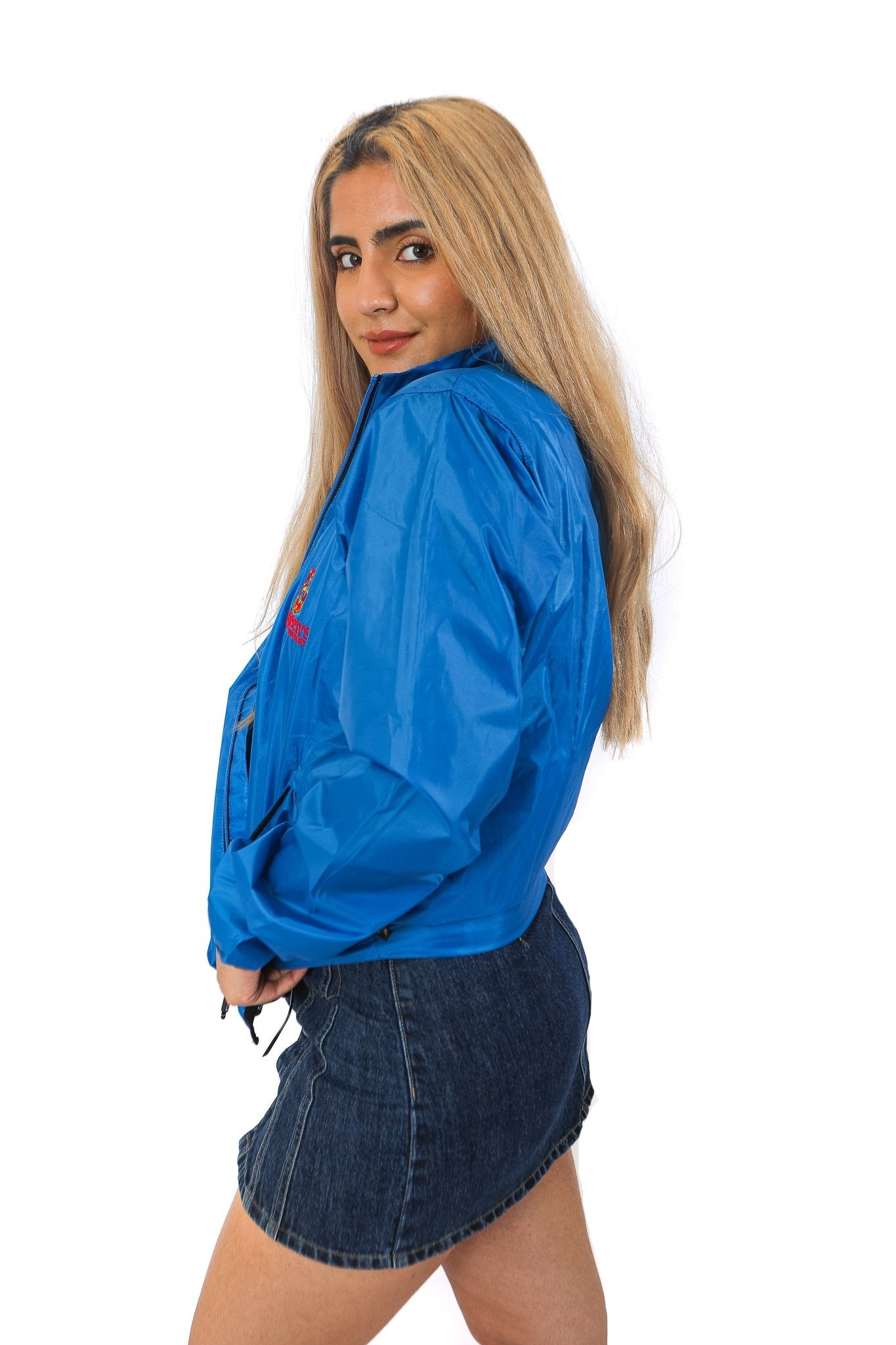 Side view of blue zip up rain jacket with red Queen's crest logo