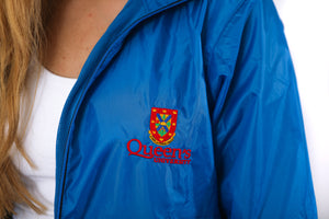 Close up of blue zip up rain jacket with red Queen's crest logo