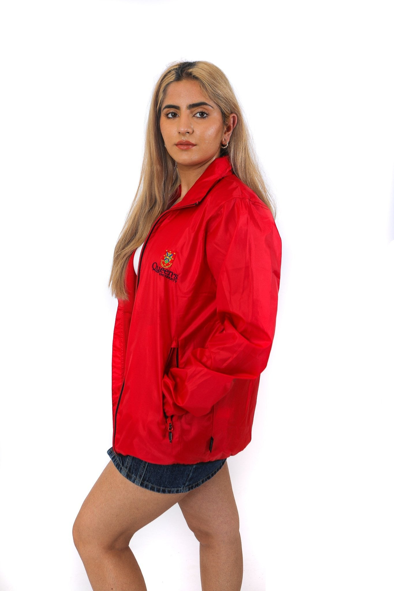Side of red zip up rain jacket with red Queen's crest logo