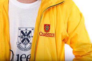 Close up of yellow zip up rain jacket with red Queen's crest logo