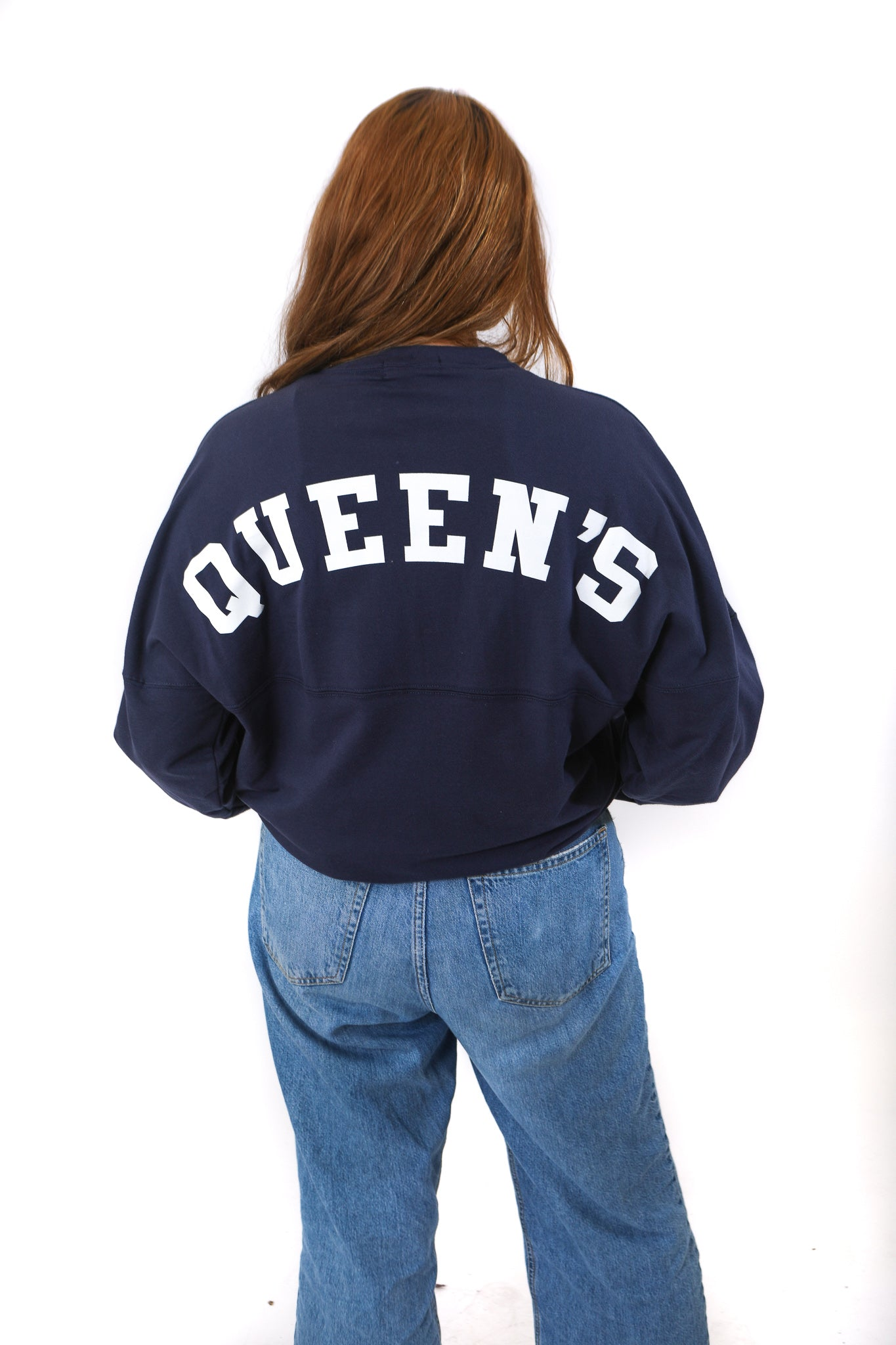 Back of blue shirt with Queen's written across in white
