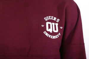 Up close of QU logo on red shirt