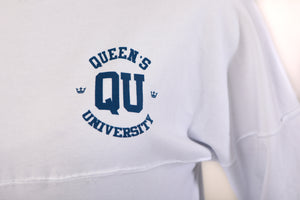 Up close of blue QU logo on white shirt