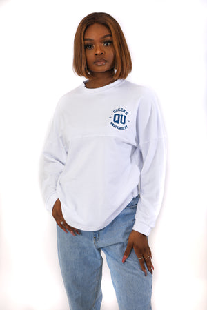 Front image of white shirt with blue QU logo