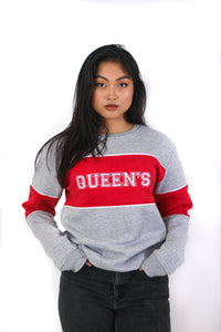 Front view of grey crewneck with bold red stripe through middle, white queen's logo over top of red