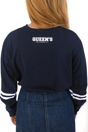 Back of navy longsleeve with striped sleeves and Queens written on the back of the neck