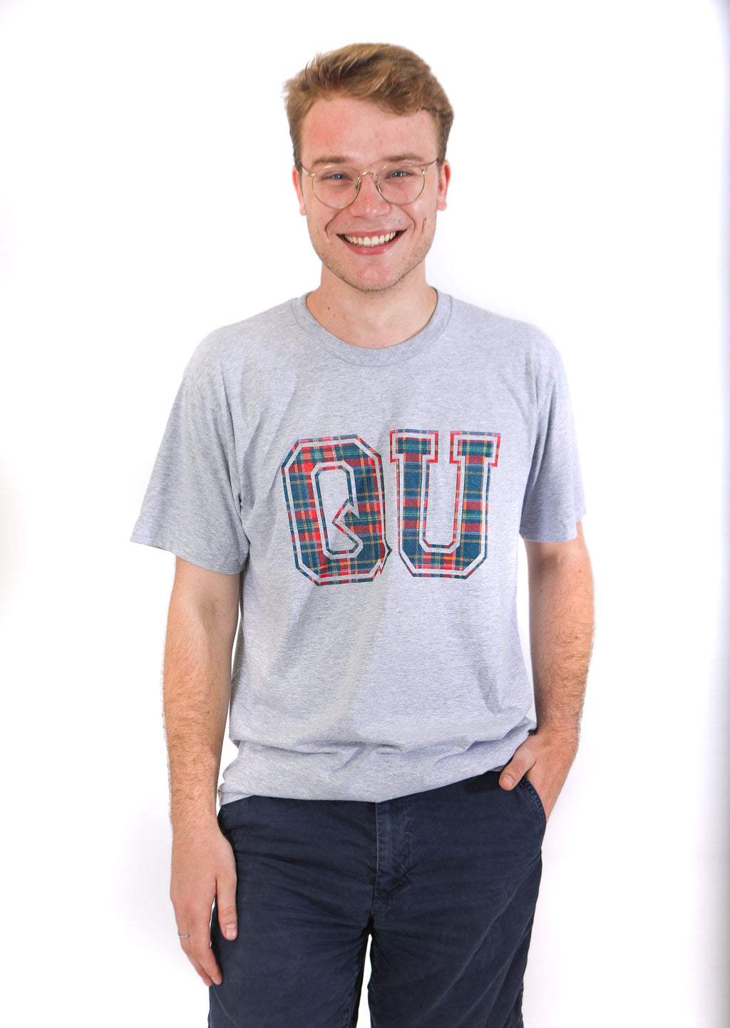 Front view of grey tshirt with large QU filled in with blue and red plaid