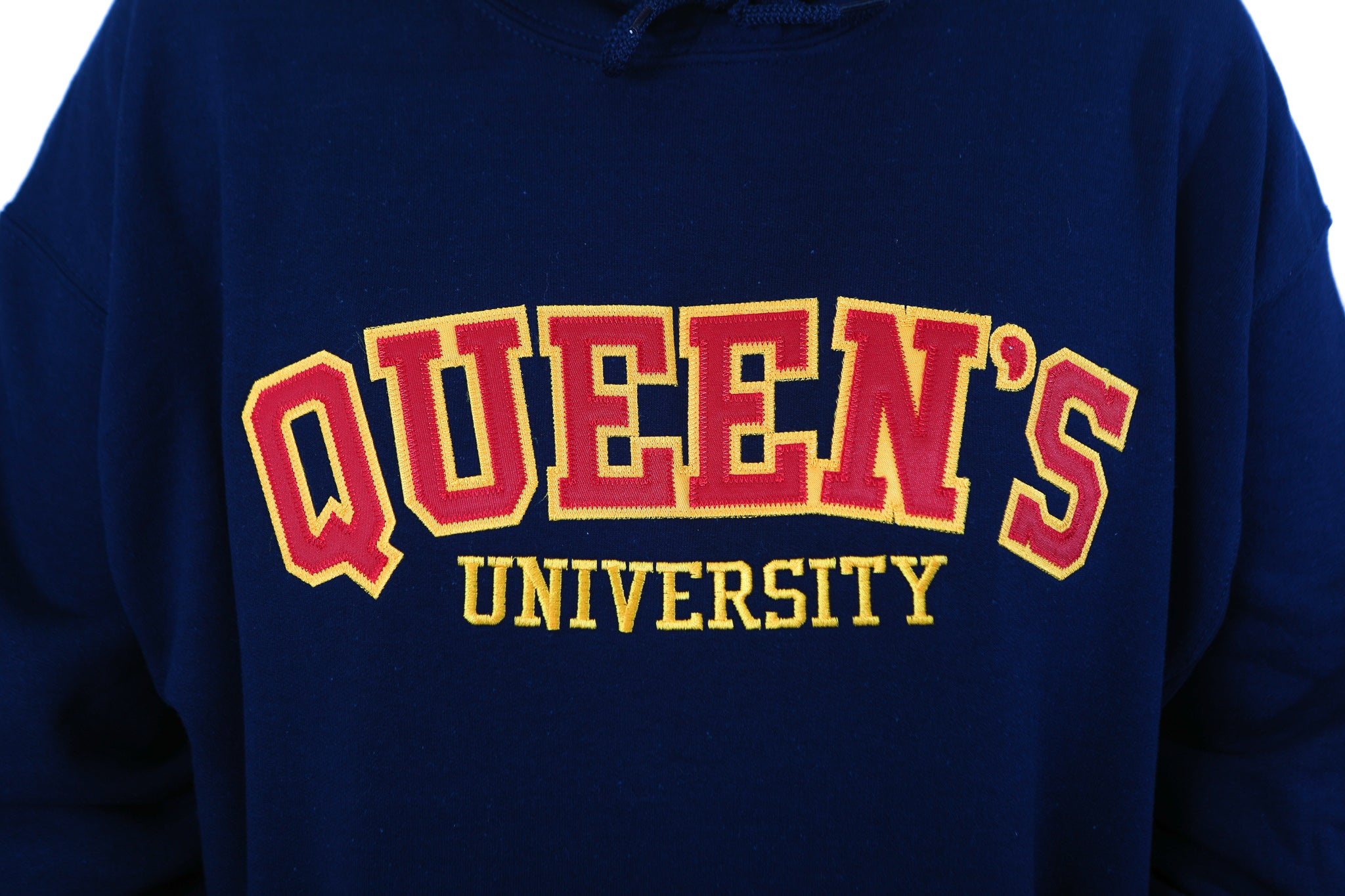 Close up of red Queen's logo on blue sweater