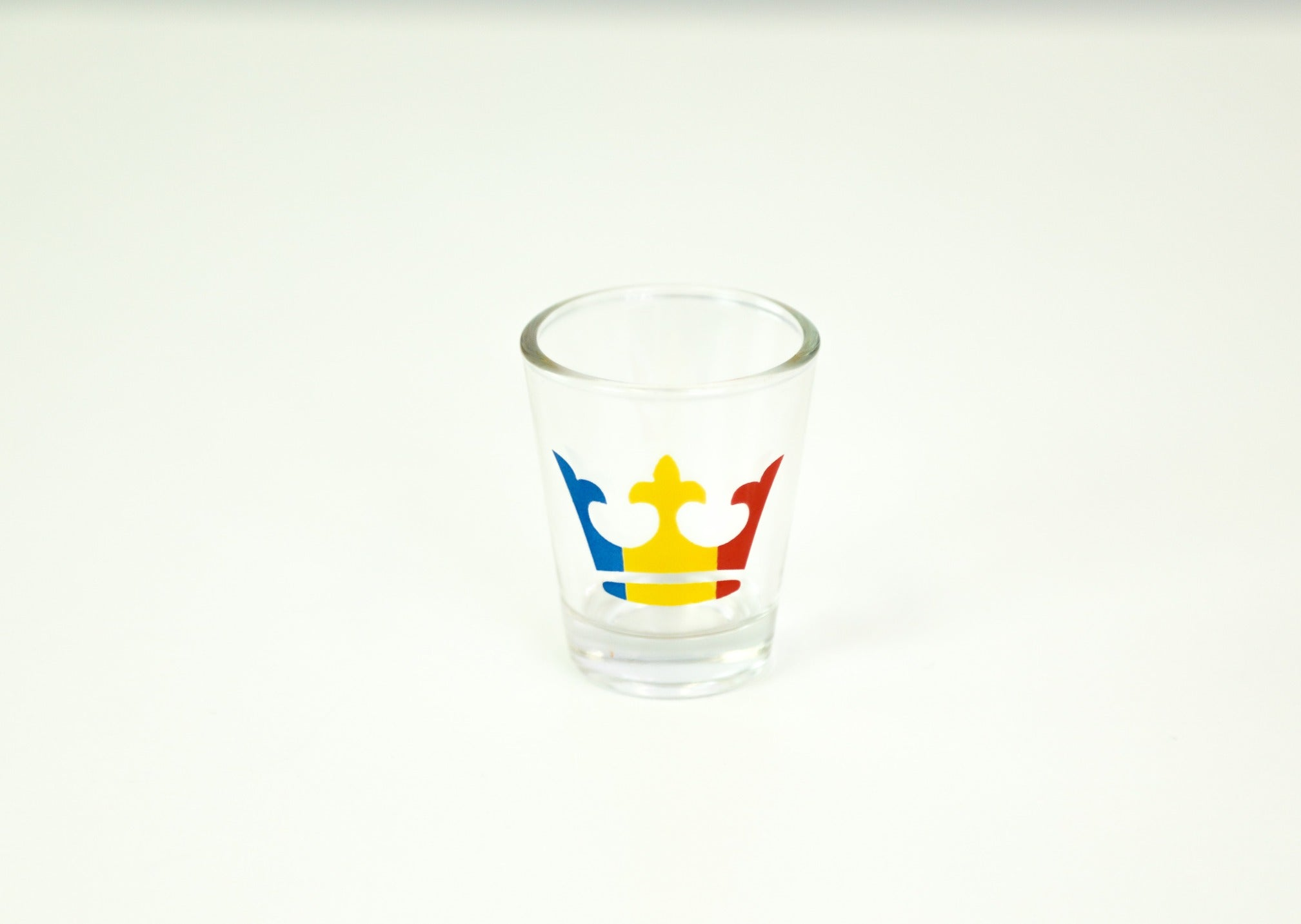 shot glass with a tricolour crown on the front