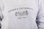 close up of model wearing a grey crewneck sweatshirt with an illustration of ontario hall