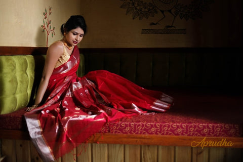 Timeless Red saree with silver gold zari border