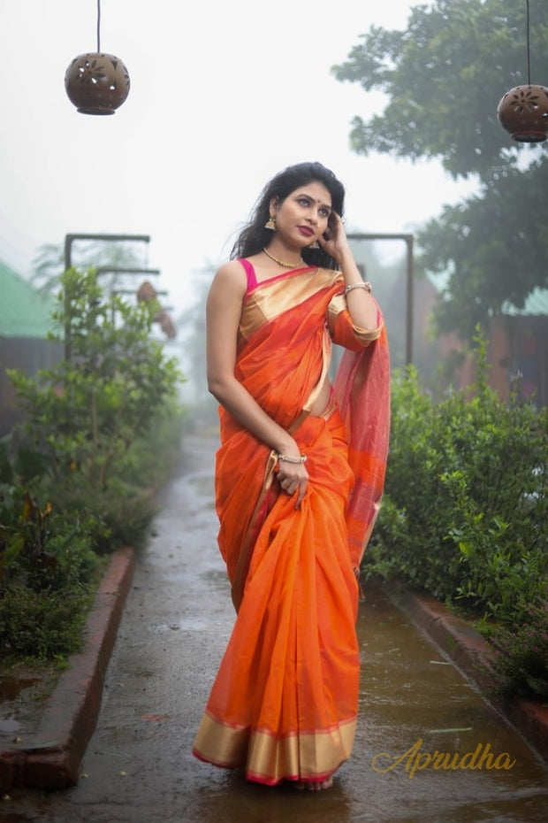 Orange silk cotton saree with gold zari border