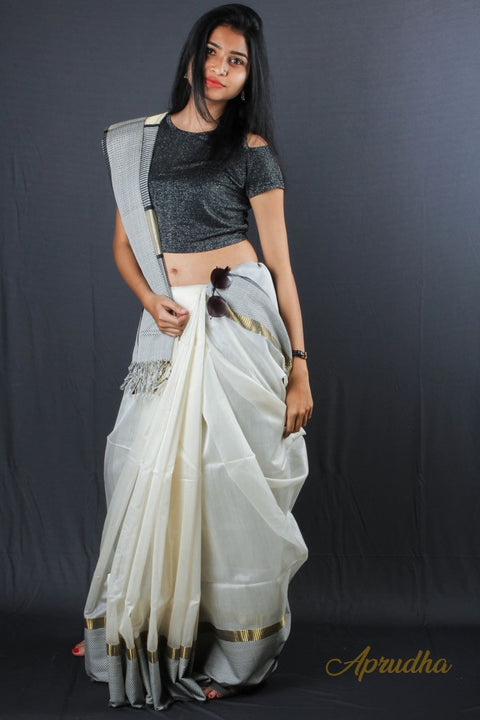 White Silk Cotton Saree with golden and chatai border