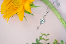 Load image into Gallery viewer, Star Key Pendant with mother of pearl center - tissinyc