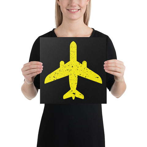Yellow Plane on Black Canvas