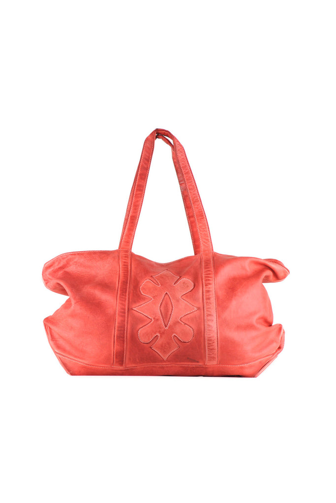 Large beach bag with flower stitching design on the front with strap.