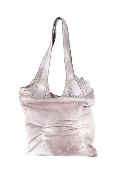 Bucket bag with detailed hand stitching and shoulder straps