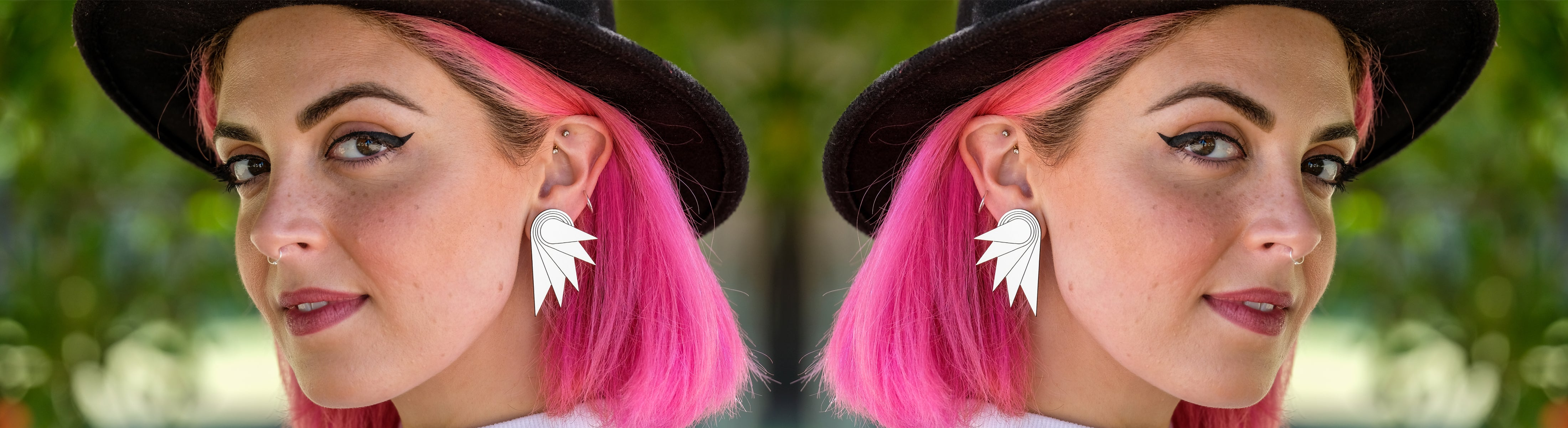 Person with pink hair wearing Maine and Mara statement jewellery Wings clip-on earrings in silver