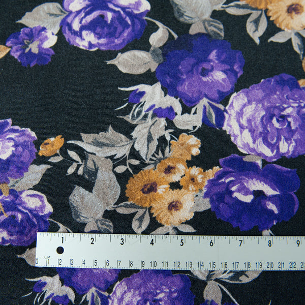 Black Jersey Dressmaking Fabric With Purple and Mustard Flowers