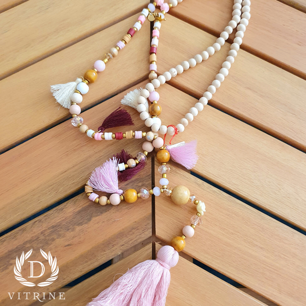 Collier pompons rose