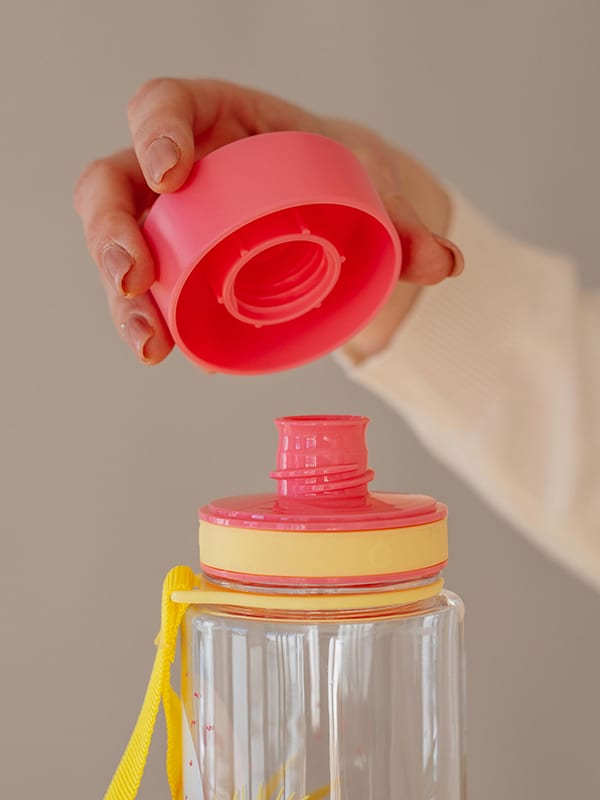 EQUA BPA FREE water bottle, Flamingo, close up of the lid and mouthpiece, pink and yellow color