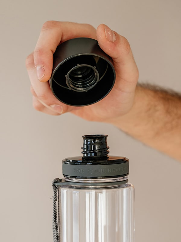 EQUA BPA FREE water bottle, Plain Black, close up of the lid and mouthpiece, black color