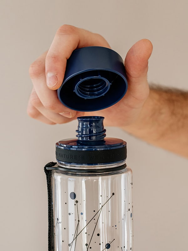 EQUA BPA FREE water bottle, Universe, close up of the lid and mouthpiece, dark blue color