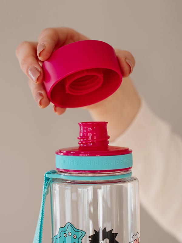 EQUA BPA FREE water bottle, Pink Monsters, close up of the lid and mouthpiece, pink and mint color