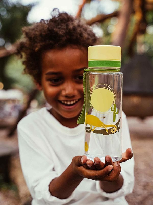 EQUA BPA FREE water bottle, Chameleon, happy and smiling boy holding water bottle in his hands, motif of chameleon, yellow and green color