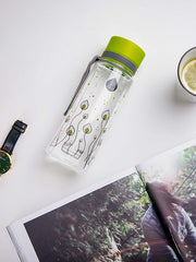 EQUA BPA FREE water bottle, Green leaves, water bottle on the table together with some tea and a magazine, motif of leaves, bright green and grey color