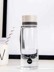EQUA BPA FREE water bottle, Plain Grey, bottle standing on the office table, minimalistic design, no motif, grey color