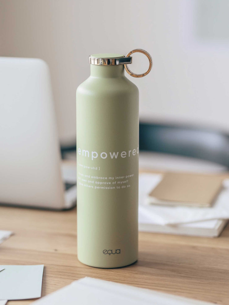 Empowered bottle with text green colour on desk