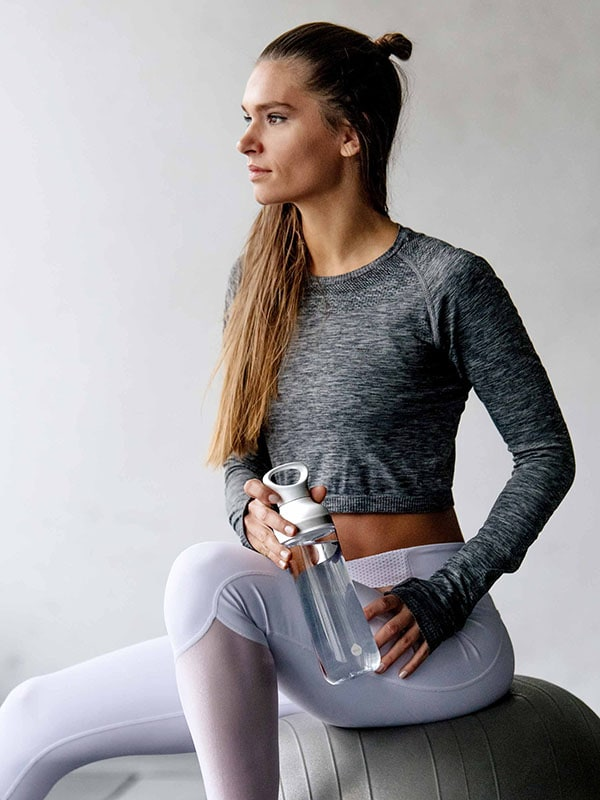 EQUA BPA FREE FLOW water bottle, Freeze, yoga girl holding bottle in her hands, minimal design, no motif, grey color